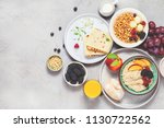 breakfast. oatmeal with berries ... | Shutterstock . vector #1130722562
