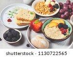 breakfast. oatmeal with berries ... | Shutterstock . vector #1130722565