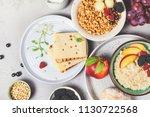 breakfast. oatmeal with berries ... | Shutterstock . vector #1130722568