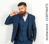 handsome bearded businessman in ... | Shutterstock . vector #1130746472