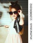 lifestyle portrait of stylish... | Shutterstock . vector #1130800202