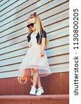 lifestyle portrait of stylish... | Shutterstock . vector #1130800205