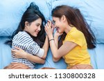 two asian womens looking at... | Shutterstock . vector #1130800328