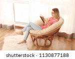young woman reading interesting ... | Shutterstock . vector #1130877188