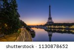 eiffel tower and the seine... | Shutterstock . vector #1130878652