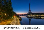 eiffel tower and the seine... | Shutterstock . vector #1130878658