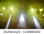 yellow light  smoke  floodlight ... | Shutterstock . vector #1130883602