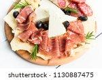 dish of prosciutto crudo ham ... | Shutterstock . vector #1130887475