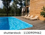 empty cozy chaise lounges near... | Shutterstock . vector #1130909462