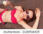 young woman getting suntan with ... | Shutterstock . vector #1130936525