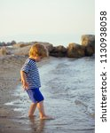 boy in sea. cute baby boy plays ... | Shutterstock . vector #1130938058