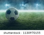 soccer ball lays in flood light ... | Shutterstock . vector #1130970155