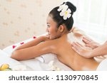 woman lying down on a massage... | Shutterstock . vector #1130970845
