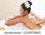 woman lying down on a massage...   Shutterstock . vector #1130970845