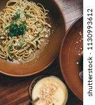 spaghetti pasta with pesto... | Shutterstock . vector #1130993612