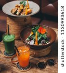 green salad with caramelised... | Shutterstock . vector #1130993618