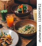 spaghetti pasta with pesto... | Shutterstock . vector #1130993912