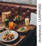 spaghetti pasta with pesto... | Shutterstock . vector #1130994302
