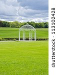 white gazebo by a pond | Shutterstock . vector #113102428