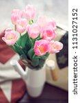 pink tulips bunch in vase.... | Shutterstock . vector #1131027152