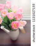 pink tulips bunch in vase.... | Shutterstock . vector #1131027155
