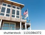 beachfront property with flags...   Shutterstock . vector #1131086372