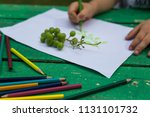 the child draw fruits with... | Shutterstock . vector #1131101732