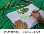 the child draw fruits with... | Shutterstock . vector #1131101735