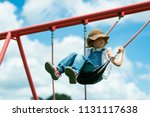 girl playing in the park | Shutterstock . vector #1131117638