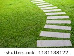 Pathway in the garden, forward stepping stones in the grass lawn. Using for the roadway to success, achievement, leadership, milestone, vision, and mission concept.