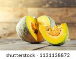 slice of pumpkin on wooden... | Shutterstock . vector #1131138872