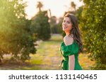 beautiful young woman  outdoors ... | Shutterstock . vector #1131140465