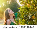 beautiful young woman  outdoors ... | Shutterstock . vector #1131140468