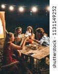 group of friends drink beer on... | Shutterstock . vector #1131149252