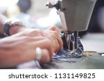 sewing denim jeans with sewing... | Shutterstock . vector #1131149825