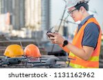 young asian man working with... | Shutterstock . vector #1131162962