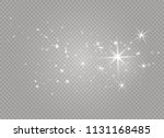 white sparks and golden stars... | Shutterstock .eps vector #1131168485
