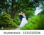 happy wedding couple hugging on ... | Shutterstock . vector #1131210236