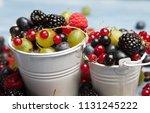 various fresh summer berries.... | Shutterstock . vector #1131245222