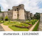 Small photo of Garden and Structure of Château d'Angers, a castle in the city of Angers in the Loire Valley, France and founded in the 9th century by the Counts of Anjou.