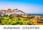 ostuni white town skyline and... | Shutterstock . vector #1131247262