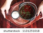 bowl of red soup with spices... | Shutterstock . vector #1131251018