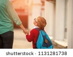 parent take child to school.... | Shutterstock . vector #1131281738
