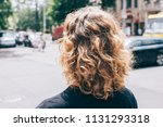 woman's head with curly brown... | Shutterstock . vector #1131293318