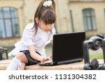 schoolgirl girl working with... | Shutterstock . vector #1131304382