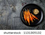 roasted carrots with dukkah.... | Shutterstock . vector #1131305132