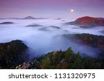 misty night landscape with moon.... | Shutterstock . vector #1131320975