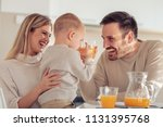 cheerful young family making... | Shutterstock . vector #1131395768