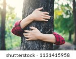 human hugging big tree color of ... | Shutterstock . vector #1131415958