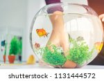 a woman's hand is decorating... | Shutterstock . vector #1131444572